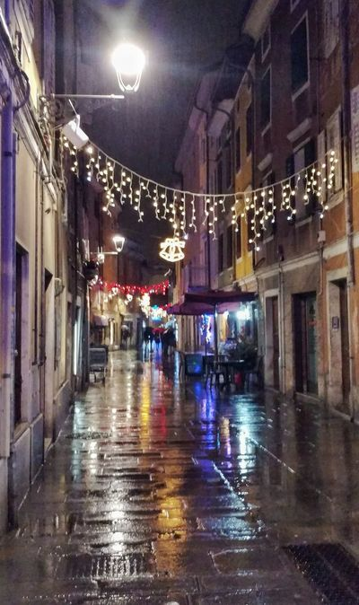 ...and rain again...ufff... Rain Illuminated Night Architecture Wet Building Exterior No People Built Structure Water City Indoors  Storytelling Christmas Light Christmas Decorations Cristmas Around The World Italy Italian Muggia Trieste Europe Travel Tourisnm Colours Colorful Shades Of Winter