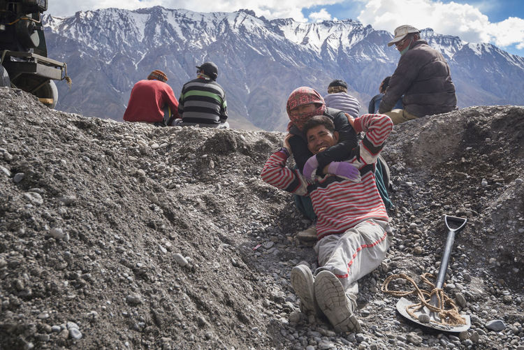 Workers having a fun moment at Ki Monastery, Spiti Valley, India. India Travel Adventure Cold Temperature Day Full Length Hiking Himachal Lifestyles Mature Adult Mature Men Men Mountain Mountain Range Nature Outdoors People Portrait Real People Sky Snow Spiti Standing Togetherness Winter