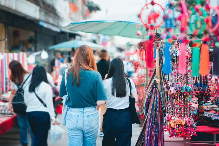 Asian woman travel and shopping at thailand night market