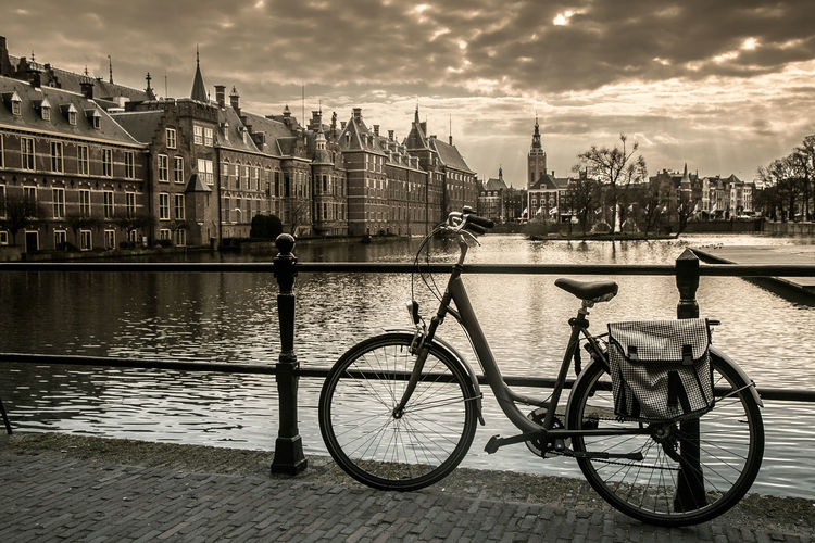 Bicycles on bridge over river in city