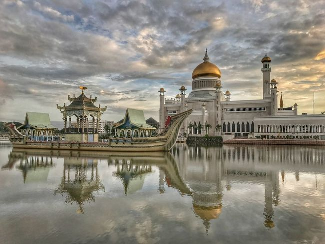 Sunrise in Bandar Seri Begawan Architecture Dome Built Structure Religion Building Exterior Place Of Worship Sky Cloud - Sky Spirituality Water Travel Destinations Reflection Outdoors Travel Waterfront History Architectural Column Day No People City Sunrise Architecture