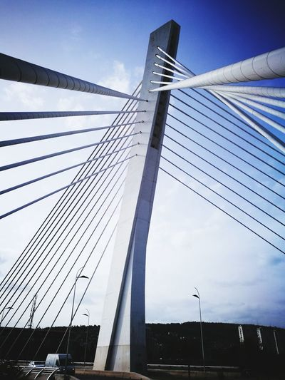 Architecture Bridge - Man Made Structure Built Structure Connection Skyscraper City Suspension Bridge Sky No People Business Finance And Industry Outdoors Travel Destinations Steel Day Low Angle View Building Exterior Golf Club Urban Skyline Cityscape Podgorica, Montenegro Montenegro Rural Scene Landscape Beauty In Nature Silhouette The Architect - 2017 EyeEm Awards