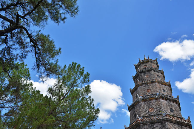 hue city, VN Huế Thien Mu Pagoda Architecture Belief Blue Building Exterior Built Structure Cloud - Sky Day History Low Angle View Nature No People Outdoors Place Of Worship Plant Sky Spire  Tower Travel Destinations Tree