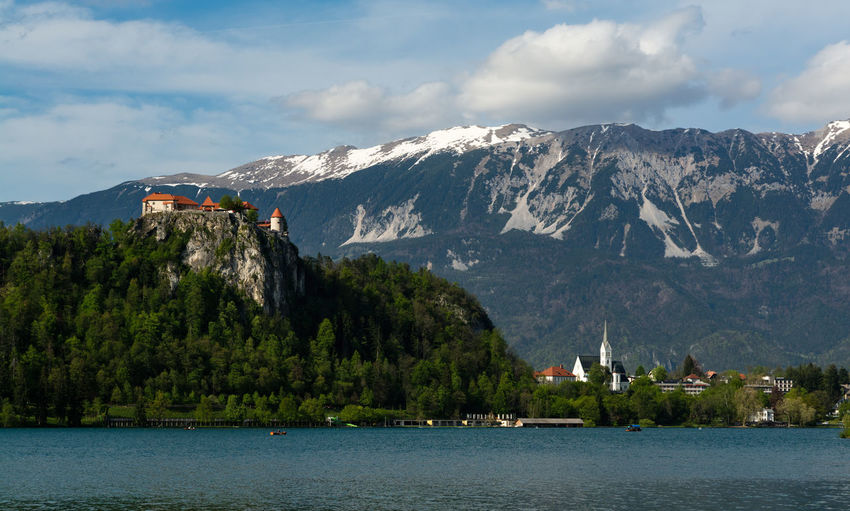 Bled lake and castle. the julian alps on the background