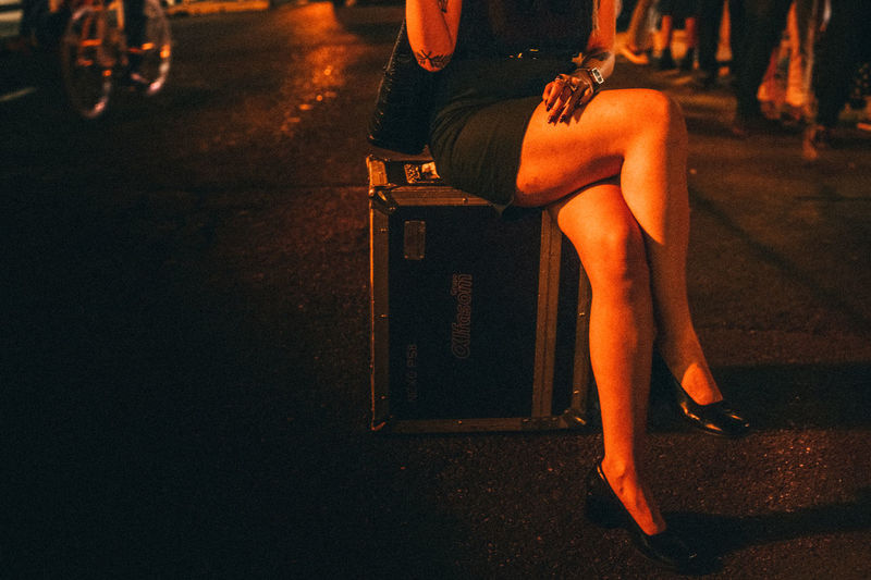 Adult Dark Darkness And Light Drinks Friends Full Length High Heels Human Leg Leisure Activity Lifestyles Low Section Night Nightclub Nightphotography One Person Outdoors People Real People Sitting Summer Summertime Women Young Adult The Street Photographer - 2017 EyeEm Awards Live For The Story