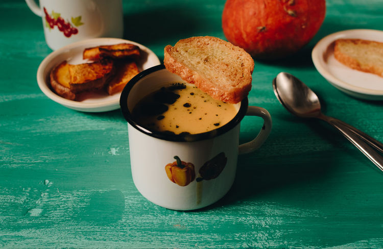 Comfort Food Homemade Food Pumpkin Soup Seasonal Food Bowl Bread Close-up Day Fall Foods Food Food And Drink Freshness Healthy Eating Indoors  No People Orange Color Plate Pumpkin Ready-to-eat Serving Size Slice Of Bread Table Traditional Food Turquoise Color Vibrant Colors Food Stories Autumn Mood