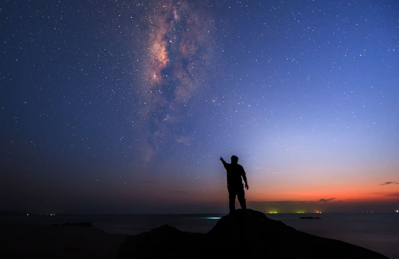 Man watching milkyway galaxy Night Astronomy Star - Space Milky Way Space And Astronomy Sky Arts Culture And Entertainment Travel Nature Space Sea Galaxy Science Landscape People Beauty In Nature Outdoors Adult Sea And Sky Seascape Orange Sunset Solar Eclipse Galaxy Zodiac