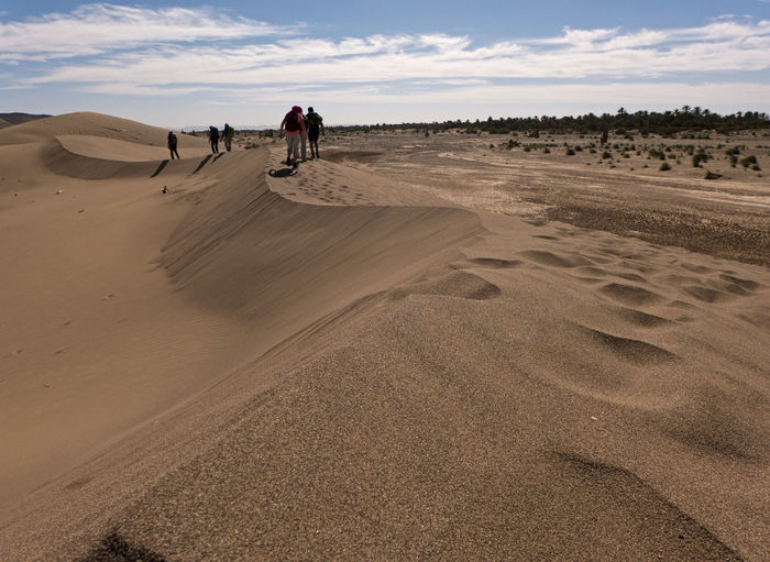 Desert walk near Zagora Morocco. Sand Land Desert Landscape Scenics - Nature Climate Arid Climate Tranquility Beauty In Nature Nature Non-urban Scene Outdoors Sahara Dunes Africa Trekking Adventure Hiking Wanderlust Real People Leisure Activity Lifestyles Cloud - Sky