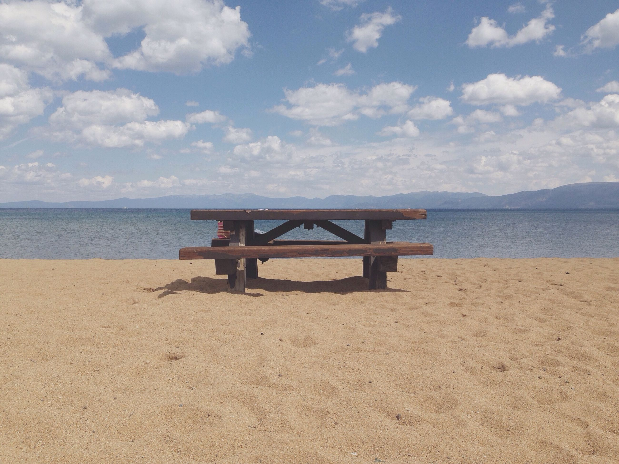 sea, water, sky, tranquil scene, tranquility, beach, scenics, horizon over water, beauty in nature, cloud - sky, pier, nature, sand, cloud, built structure, shore, idyllic, day, calm, outdoors