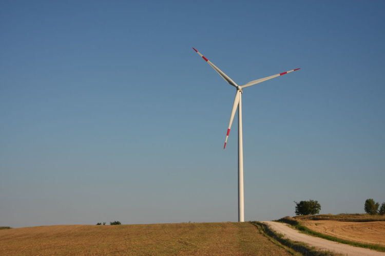 Wind Turbine On Field In A Sunny Day