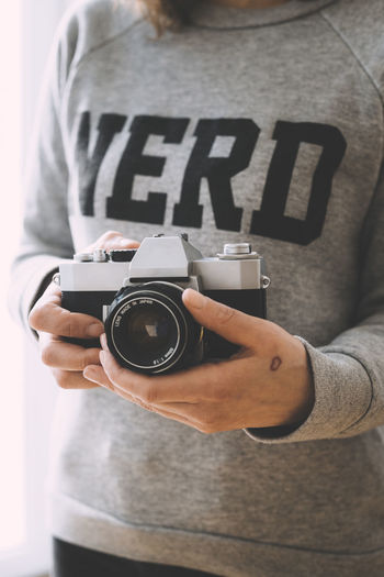 NERD 35mm 35mm Film Camera Camera - Photographic Equipment Holding One Person One Woman Only People Photographer Photographing Photography Themes Retro Retro Styled SLR Camera Tattoo Technology Vintage Woman