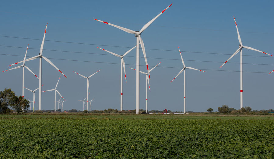 Wind turbines onshore at the North Sea coast of Schleswig Holstein Wind Turbine North Sea Coast Schleswig Holstein Energy Wind Electrical Energy Electricity Grid Wind Power Plant Windmill Grid Connection Wind Energy Renewable Energy Energy Transition Rotor Blade Power Generation Heat Generation Energy Supply District Heating Power Plant Nature Renewable Subsidy Environment Environmental Protection