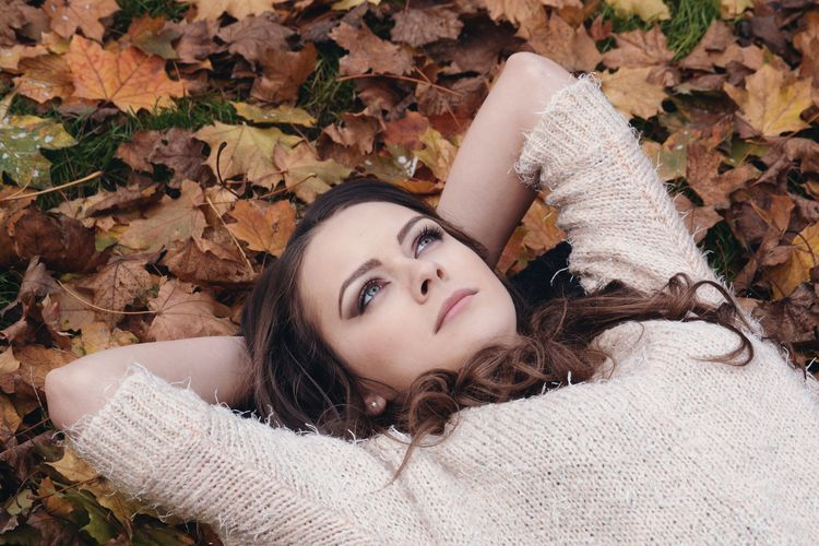 Adult Autumn Beautiful Woman Beauty Close-up Day Front View Leaf Leisure Activity Lifestyles Long Hair Looking At Camera Lying Down Lying On Back Nature One Person Outdoors People Portrait Real People Smiling Tree Young Adult Young Women