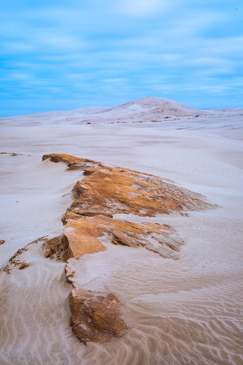 Stunning Te Paki Sand Dunes in Northland Desert Flow  Scenic Travel Beauty In Nature Cloud - Sky Day Dry Environment Idyllic Land Landscape Long Exposure Motion Nature New Zealand No People Remote Sand Sand Dune Scenics - Nature Sky Tranquil Scene Tranquility Travel Destinations