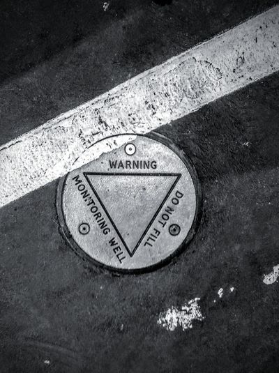 Triangle Shape Shapes Triangle Inside A Circle Triangle Within A Circle Geometric Shape Steel Plate Steel Metal Metal Plate White Stripe Whiteline Black And White Black & White Blackandwhite WesternScript Text&symbols Text And Symbols Don't Fill DoNotFill. Donotfill Do Not Fill. Do Not Fill Warning Western Script Text MonitoringWell Monitoring Well Triangle White Line Close-up