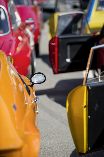 classic cars waiting at the pit for their great race with selective focus on exterior mirror Classic Car Classic Cars EyeEmNewHere Orange Red Waiting Waiting In Line Car Day Exterior Mirror Focus On Foreground Land Vehicle Mode Of Transportation Motor Vehicle No People Outdoors Race Road Selective Focus Start Street Transportation Travel Wheel Yellow