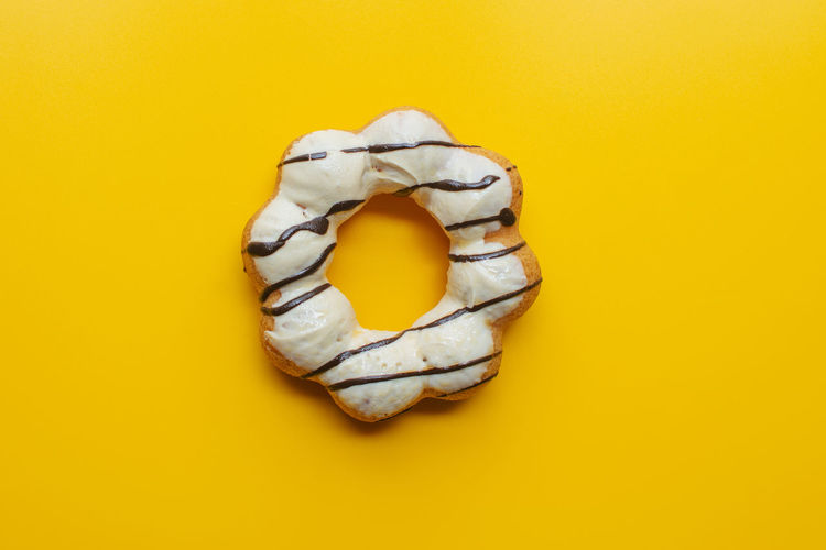 High angle view of bread on yellow background