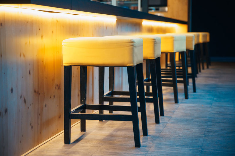 Empty stools in row at restaurant