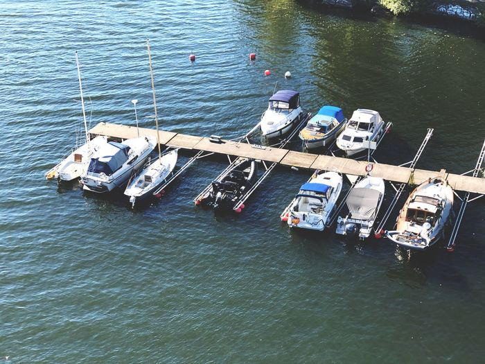 High angle view of sailboats moored in sea