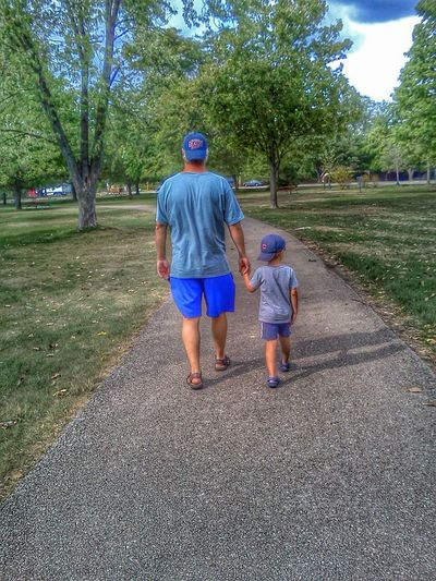 Father and son walking in a park Children Photography My Child Family Walks My Kid Color Photography Childhood Memories Color Kids Portrait People Editorial  Childhood Outdoors Walking Hand In Hand Father & Son Dad And Son Father And Son ChildrenSummer Colorful Boy Fatherhood Moments Fatherhood  Park Colors Having A Good Time