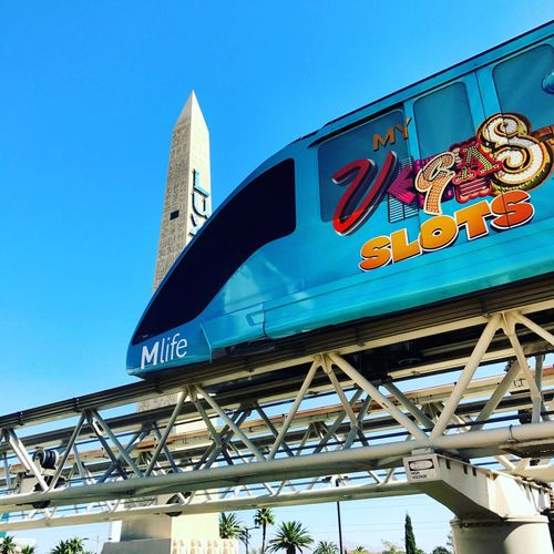 Text Western Script Communication Low Angle View Built Structure Architecture Day Guidance Outdoors Building Exterior No People Road Sign Clear Sky Sky Mode Of Transport City Life Obelisk Blue Sky Las Vegas Blvd Transportation Travel Destinations