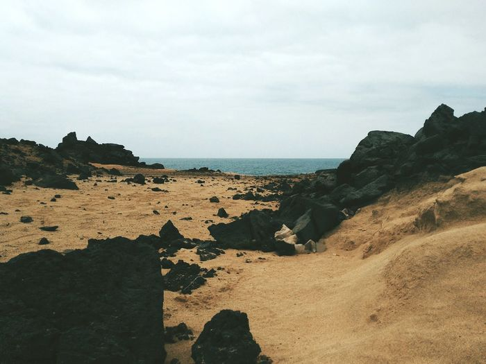 Horizon Over Water Water Sand Rock Formation Tranquility Sky Geology Beauty In Nature Beach Oceanview Coastline