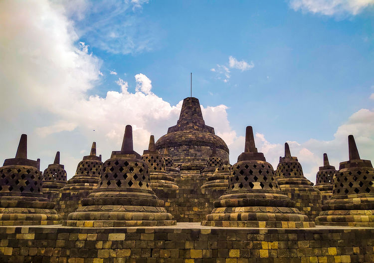 Stupas of building against sky at candi borobudur, yogyakarta, indonesia