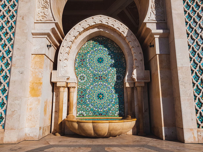 Water trap and arches at hassan ii mosque in casablanca, morocco