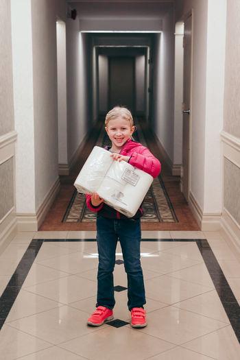 Full length portrait of girl standing at home