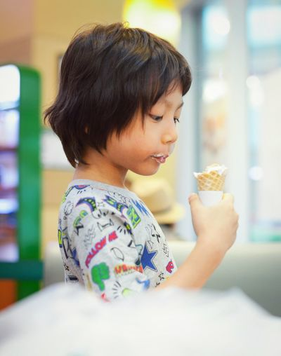 Close-Up Of Girl Eating Ice Cream