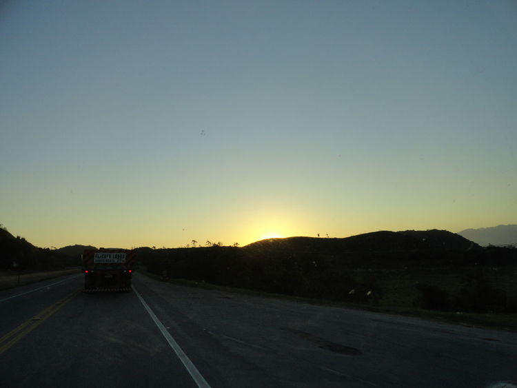 Mountain Country Road Outdoors Countryside Sun Clear Sky Transportation Road Car Sunset Mountain Range