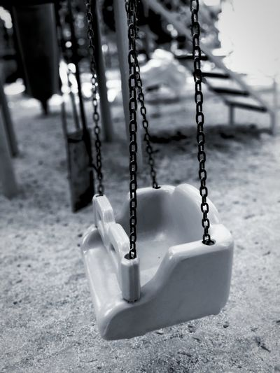 Close-up of swing hanging in playground