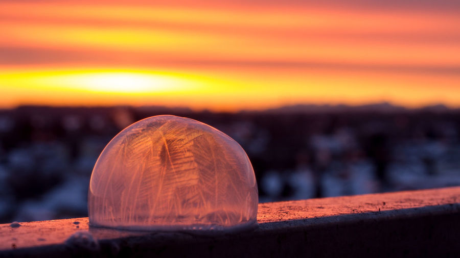 Close-Up Of Ice Crystal Against Dramatic Sky During Sunset
