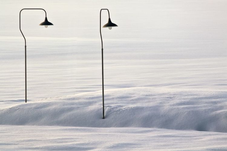 Street Light On Snowy Field During Sunny Day