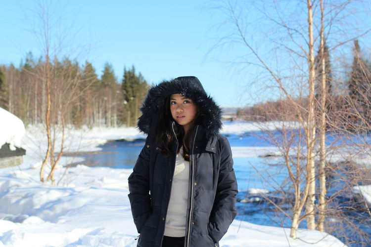Beautiful Woman Clothing Cold Temperature Day Front View Hair Hairstyle Land Leisure Activity Lifestyles Nature One Person Outdoors Plant Portrait Real People Snow Standing Tree Warm Clothing Winter Young Adult Young Women