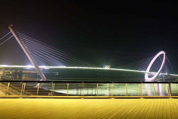 Illuminated Nanjing Eye Over River Against Clear Sky At Night