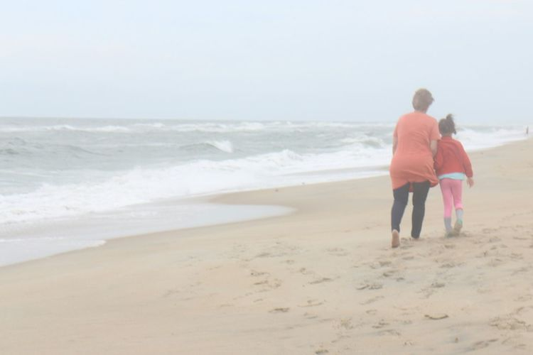 North Carolina Outer Banks, NC Beach Cloudy Day Ocean Grandmother And Grandchild Together Togetherness Walking Adventure Buddies