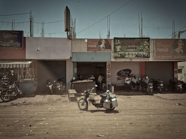 Motorcycle People Watching Retro Rural India Dusty Road Gravel Road High Noon Hot Weather Noon Retro Styled Shop Street Scene