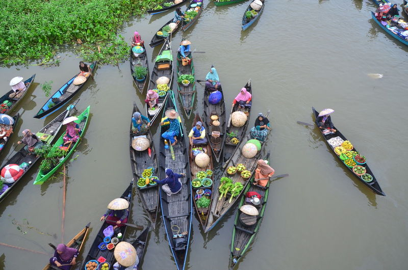 High angle view of people enjoying in river