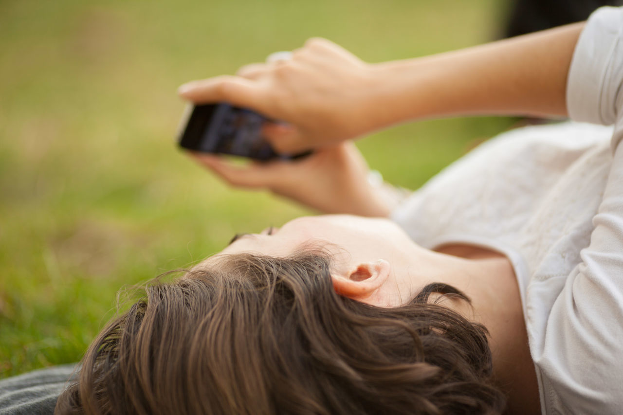 Close-up of a of young woman text messaging