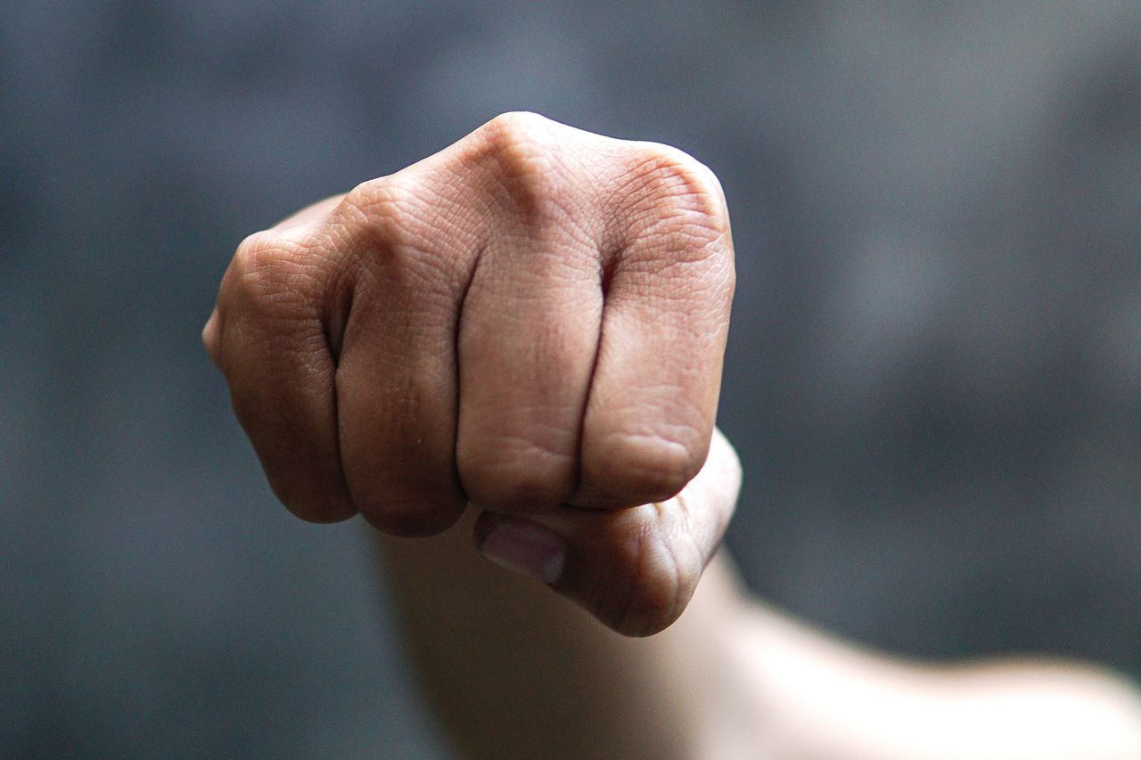 Cropped image of hand clenching fist