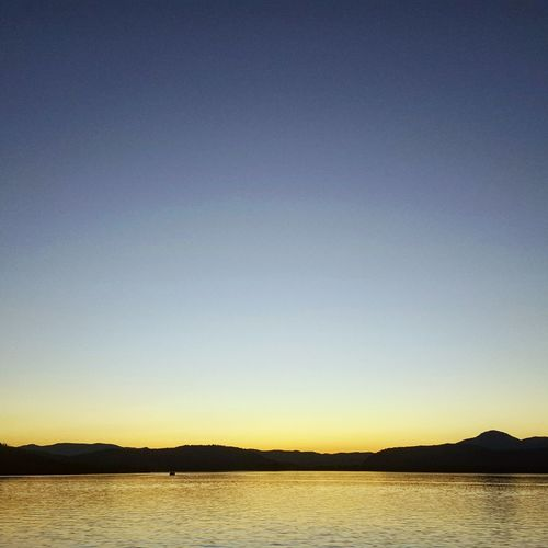 Sunset Sunset_collection Lake Pendorielle Sandpoint Idaho Mountain Skyline Fall Fall Beauty Water Tranquil Scene Clear Sky Waterfront Outdoors Water Surface Blue Mountain Range Solitude Tranquility