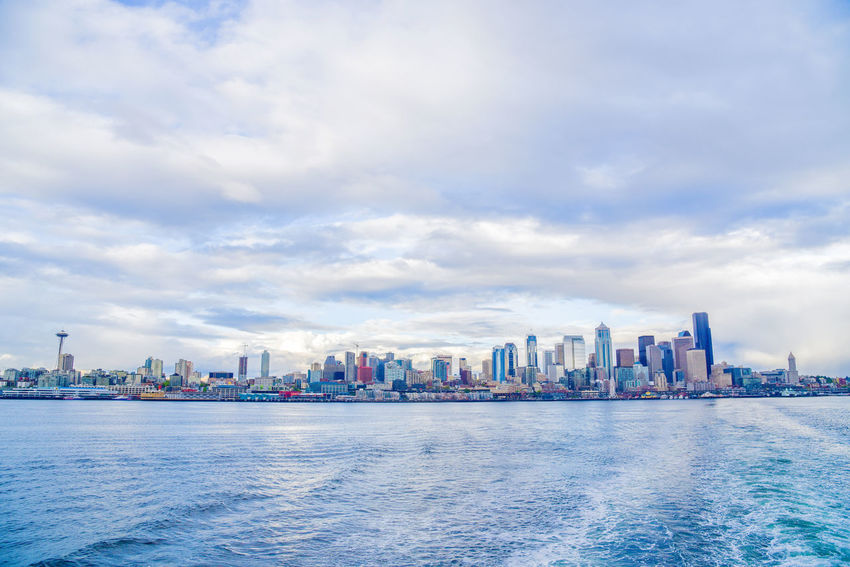 Seattle from a ferry boat. Architecture Building Exterior Built Structure Business Finance And Industry City Cityscape Cloud - Sky Day Downtown District Ferry Modern No People Outdoors Sea Seattle Sky Skyscraper Urban Skyline View Water