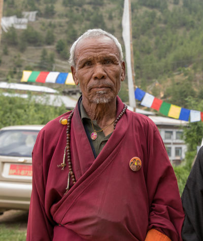 Himalayas Travel Travel Photography Adult Bhutan Bhutanese Day Gray Hair Jacket Looking At Camera Men One Man Only One Person One Senior Man Only Outdoors People Portrait Pride Real People Senior Adult Senior Men Standing Tibet Tibetan