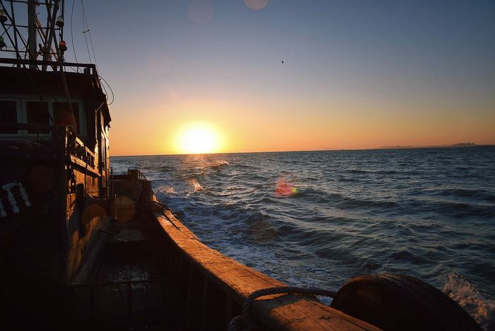 On The Ship Sea And Sky Sea View Wind Blowing  Frozen Setting Sun Taking Photos