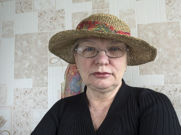 Middle aged caucasian woman in straw hat Adult Adults Only Aged Caucasian Close-up Day Eyeglasses  Hat Hat Headshot Indoors  Inspiration Looking At Camera Middle One Man Only One Person Only Men People Portrait Straw Suit Woman
