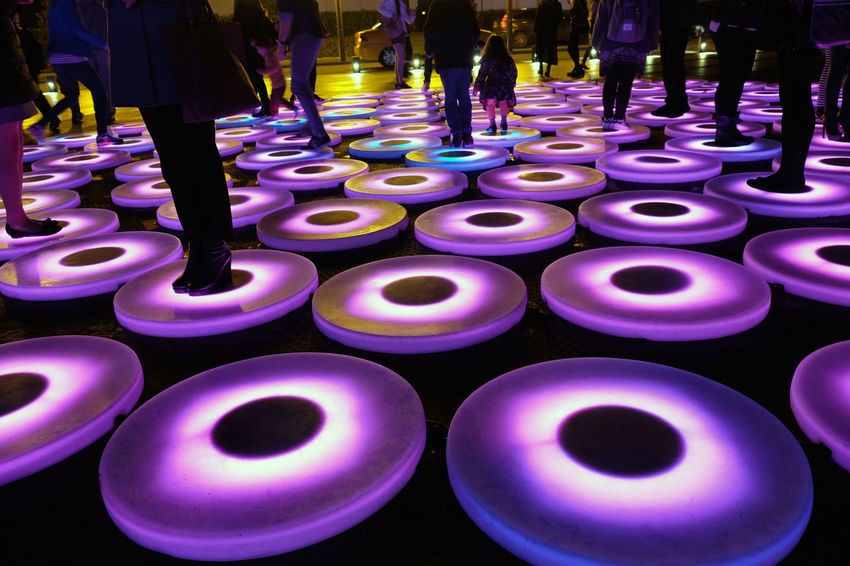 Light Festival Arrangement Beautifully Organized Colorful Colorful Lamps Colorful Rings Colorful Slives Few People Human Legs Large Group Of Objects Light Festival People Standing People Standing On Lamps Pink Color