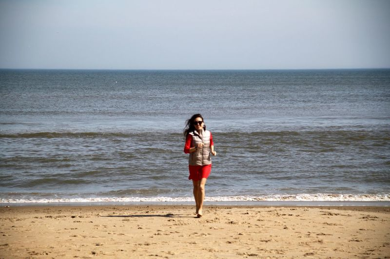 Americana Beach Photography Beach Time Emotions Happiness USA Virginia Beach Beach Beachphotography Beautiful Woman First Eyeem Photo Full Length Horizon Over Water Lifestyles Long Hair Nature One Person One Woman Only One Young Woman Only Real People Sea Vacations Water Wave