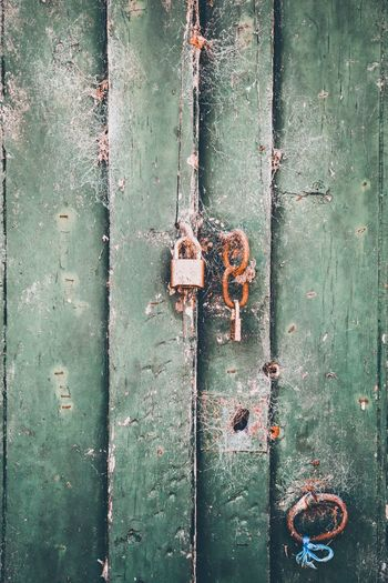 The door to where? Abbandoned Shut Lock Handle Padlock No People Full Frame Wood - Material Textured  Backgrounds Weathered Day Old Door Pattern Protection Metal Entrance Security Closed Close-up Green Color Safety Outdoors Decline
