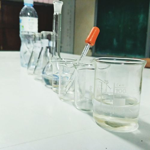 Close-up of laboratory glassware on table